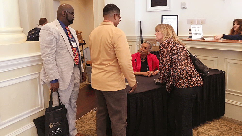 Saundra Yancy McGuire signing books for her fans