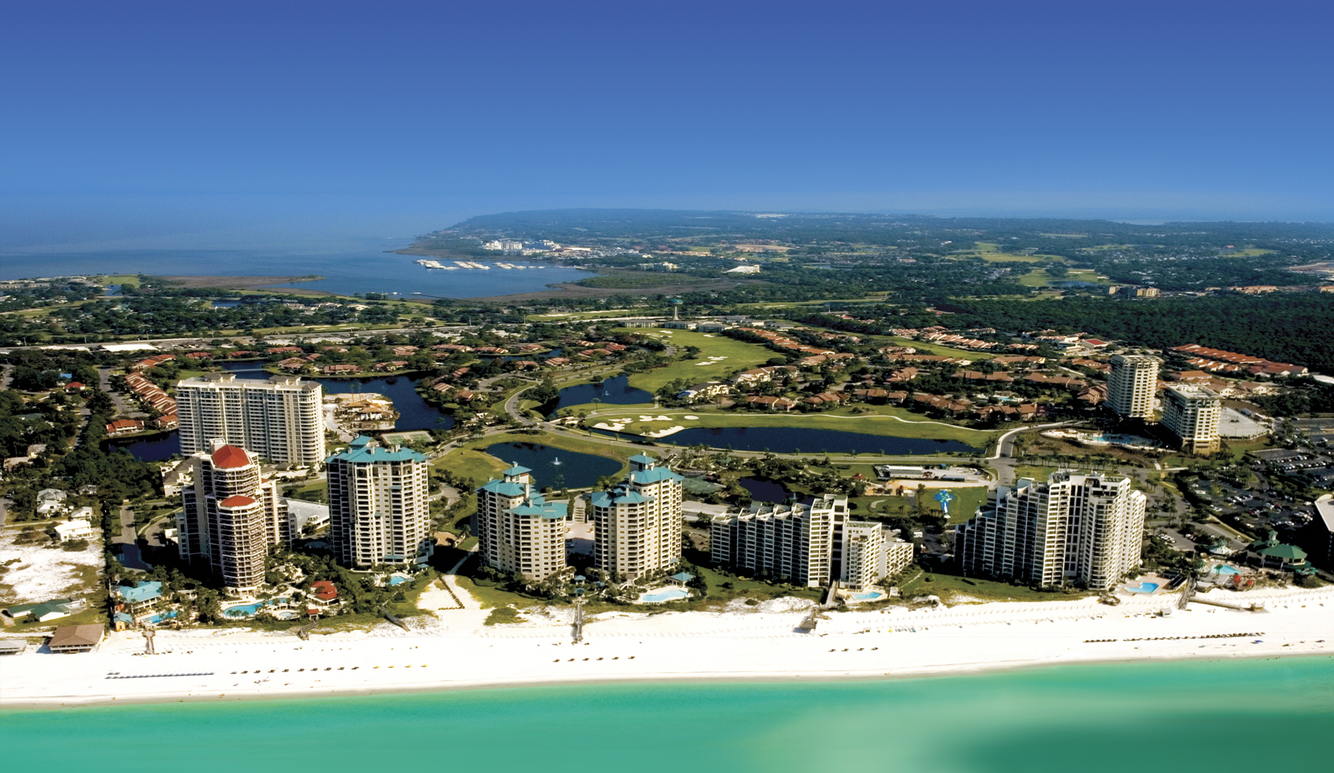 The Sandestin Resort - site of the 2017 Symposium - from the white sand beaches to the blue bay